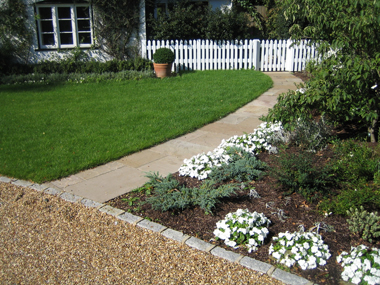 Indian Stone paving pathway and picket fencing